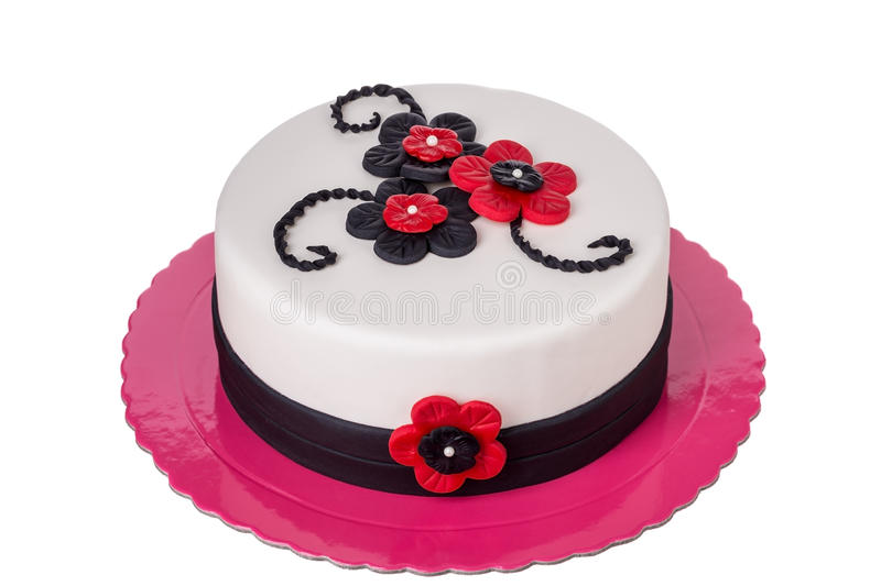 Birthday cake from sugar pastes red flowers. On birthday stock image