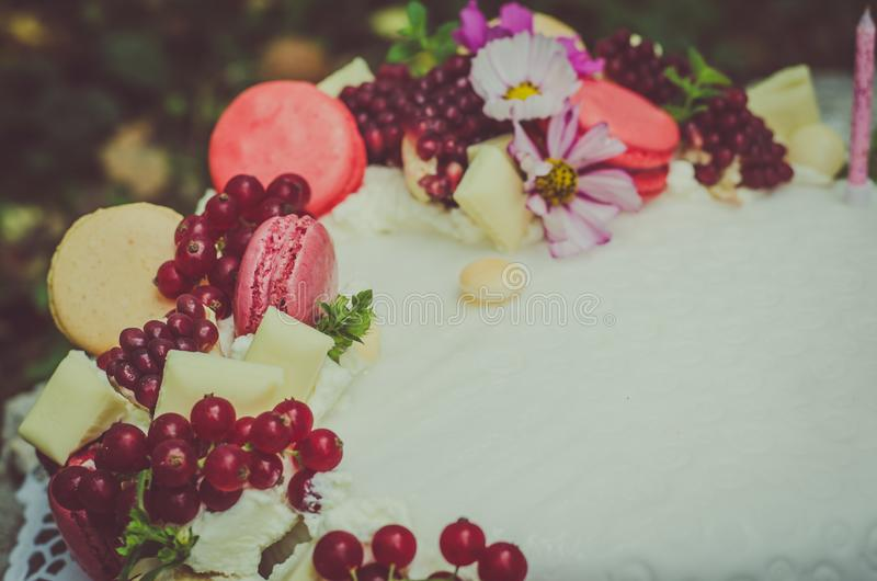 Birthday cake. Birthday or wedding cake with beautiful decoration and burning candles stock photography