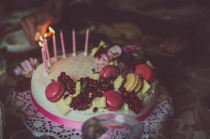 Birthday cake. Birthday or wedding cake with beautiful decoration and burning candles stock photo