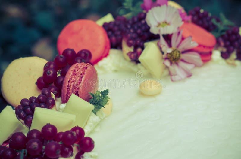 Birthday cake. Birthday or wedding cake with beautiful decoration and burning candles stock images