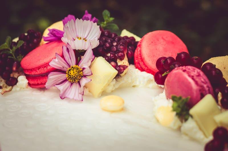 Birthday cake. Birthday or wedding cake with beautiful decoration and burning candles royalty free stock photo