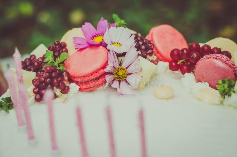 Birthday cake. Birthday or wedding cake with beautiful decoration and burning candles royalty free stock image