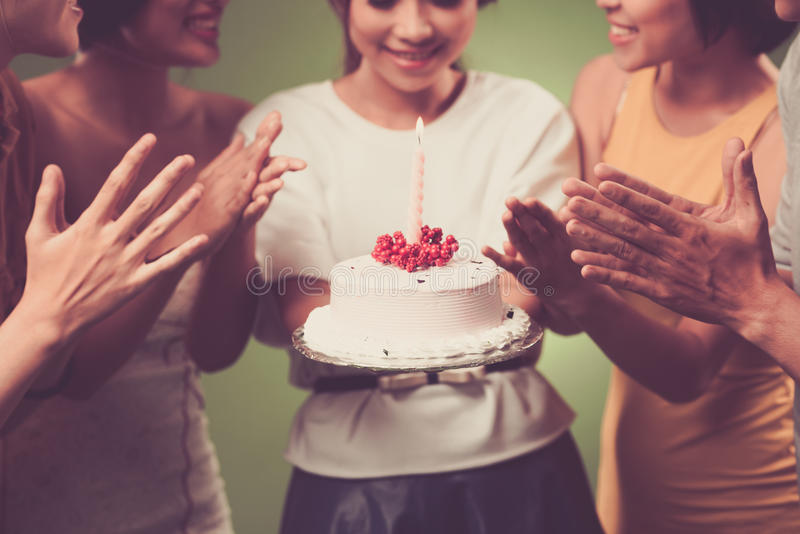 Birthday cake. Young girl holding birthday cake stock photography