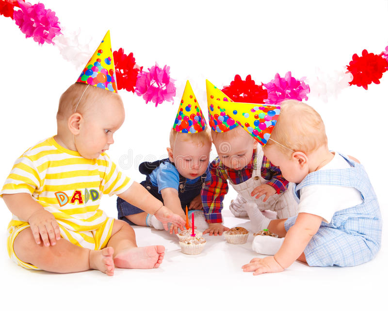 Birthday cakes. Adorable babies taking birthday cakes with candles stock photo