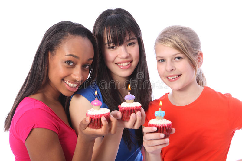 Birthday cakes for 3 mixed ethnic teenage girls. Birthday celebration with cakes for three beautiful young teenager girl friends a blonde caucasian, an oriental stock photography