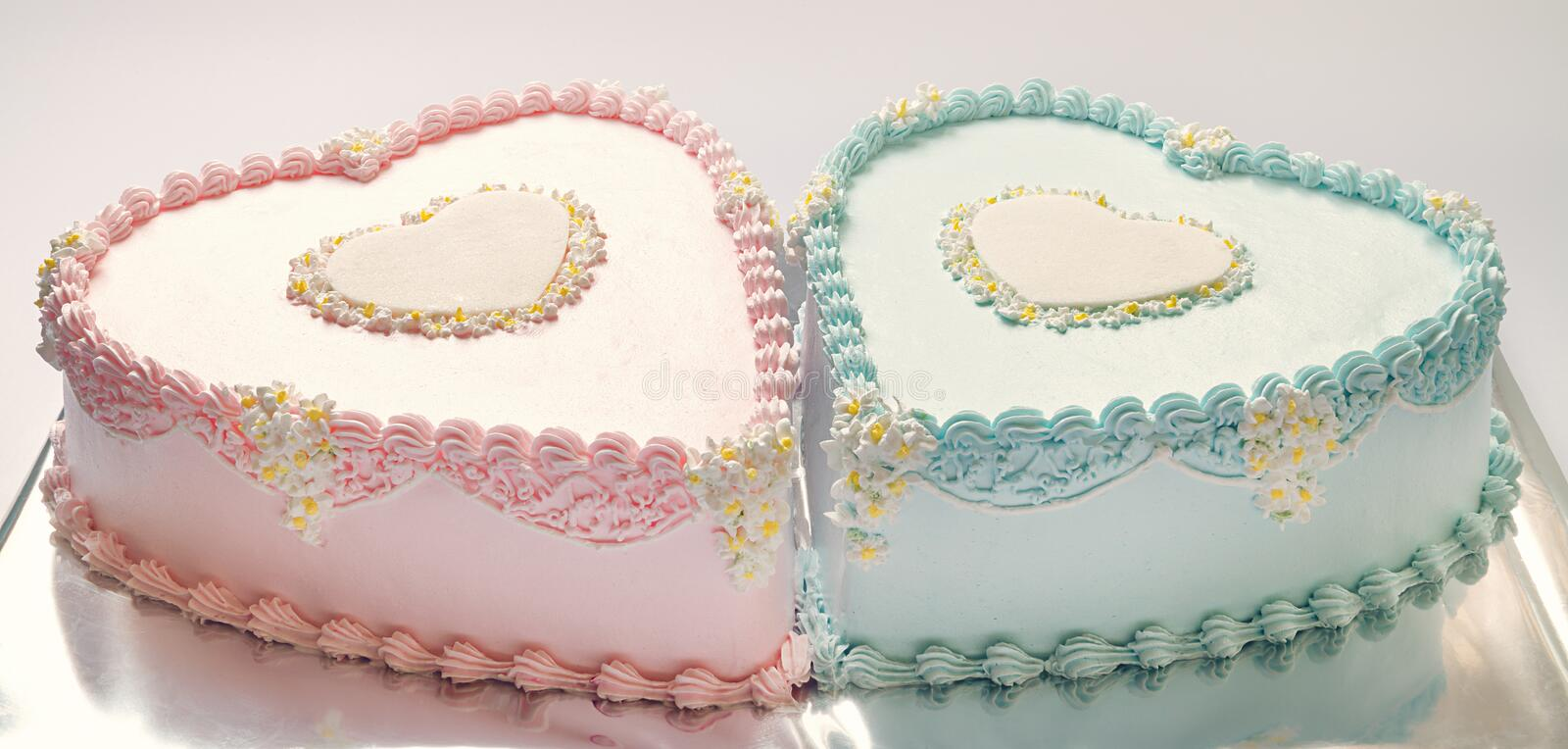 Birthday Cakes. For twins, for a boy and a girl, shape of hearts royalty free stock image