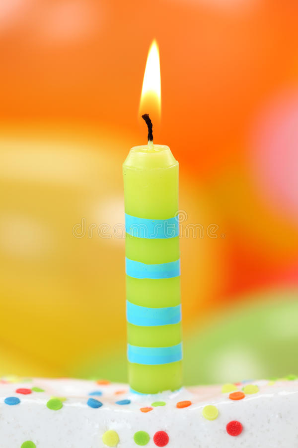 Birthday candle. On colorful background stock image