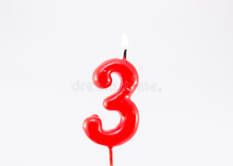 Birthday candle 3. Birthday-anniversary candle showing number 3 isolated on white stock photo