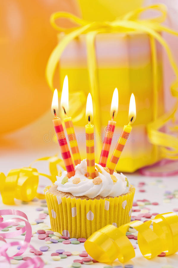 Birthday candle. On colorful background stock photos