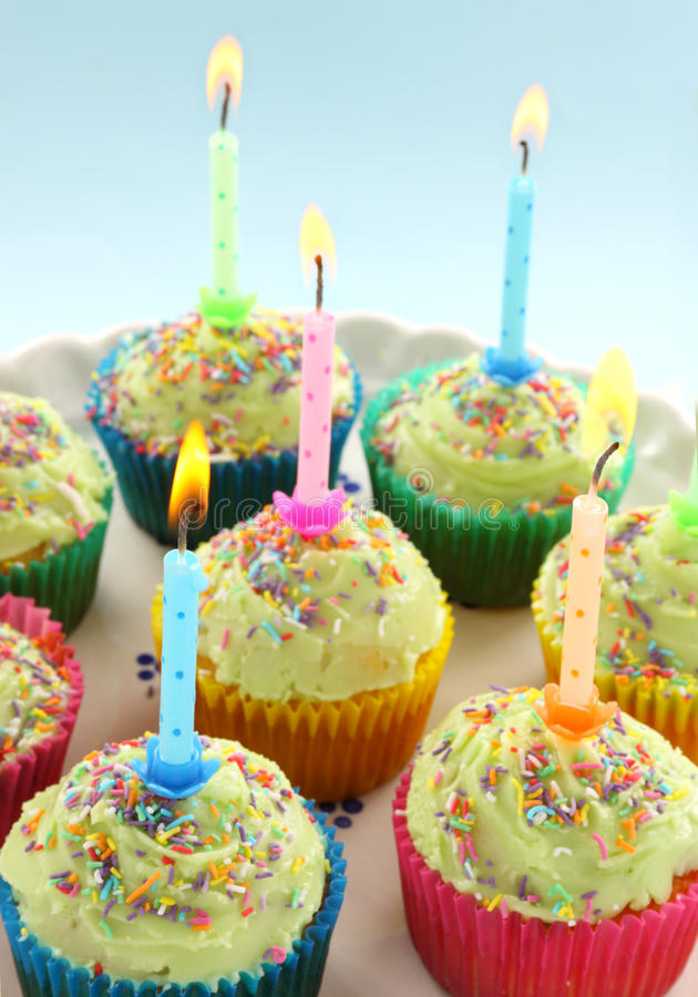 Birthday Candle Cup Cakes. Birthday cup cakes all with their own candles burning royalty free stock image