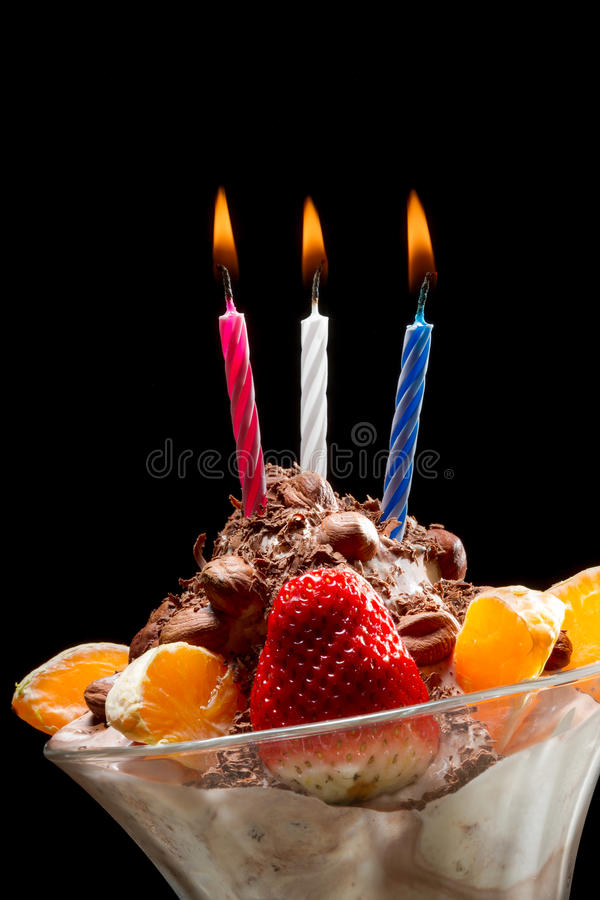Birthday candle on ice cream stock image