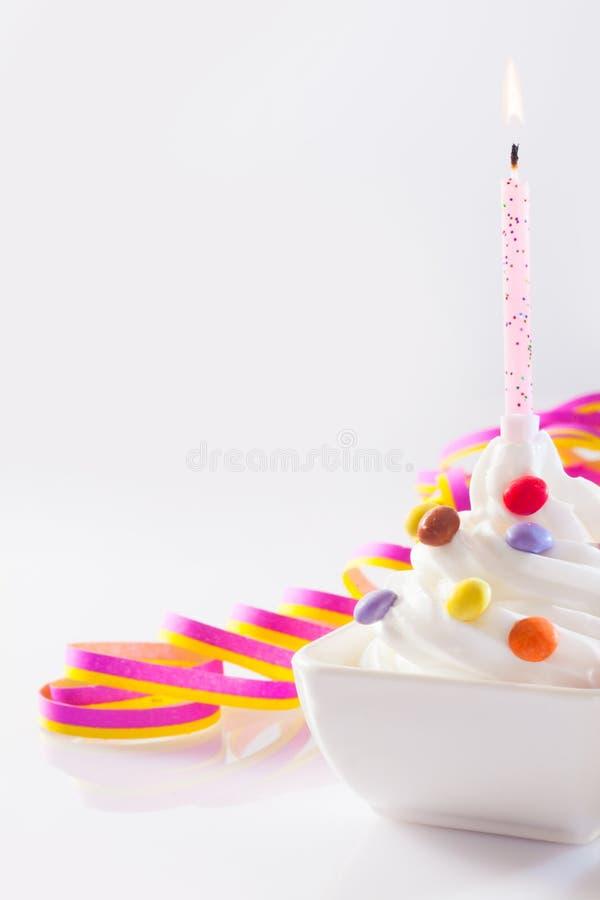 Birthday candle with ice-cream stock image