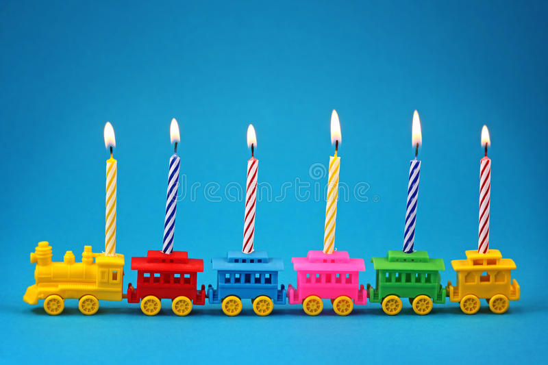 Birthday candle Train. On blue background stock images