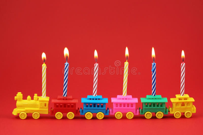 Birthday candle Train. On red background royalty free stock photos