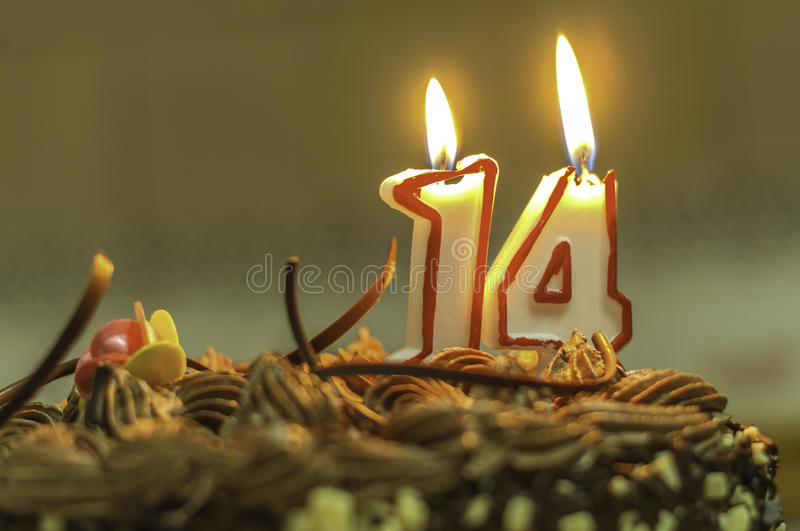 Birthday candle. 14 years birthday candle for a special age stock photos
