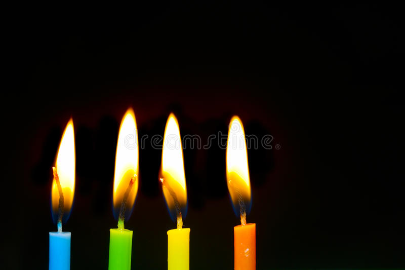 Birthday candles. On black background royalty free stock images