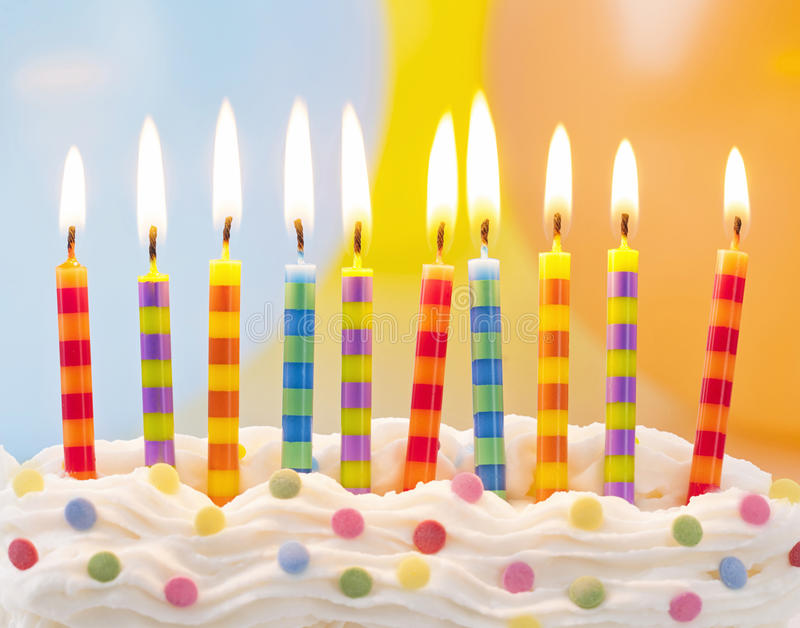 Birthday candles. On colorful background royalty free stock photography