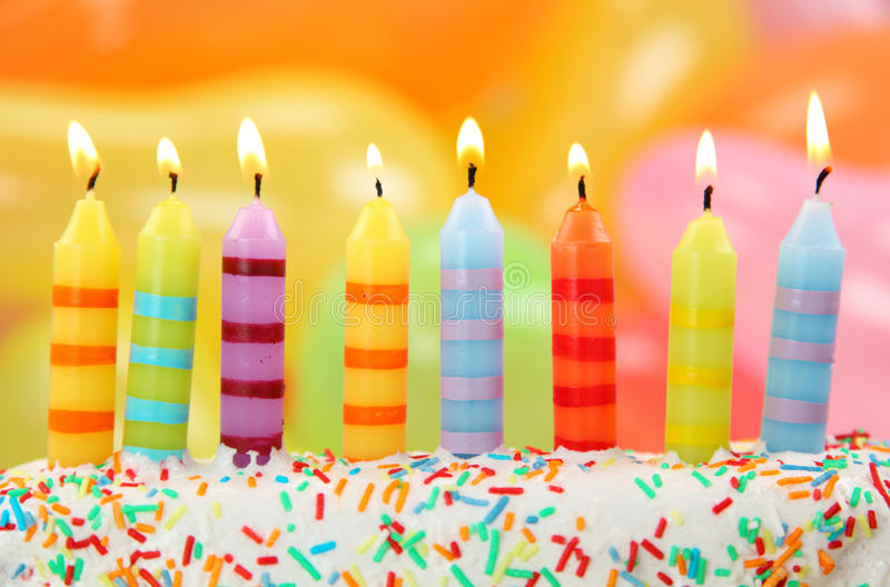 Birthday candles. On colorful background stock photos