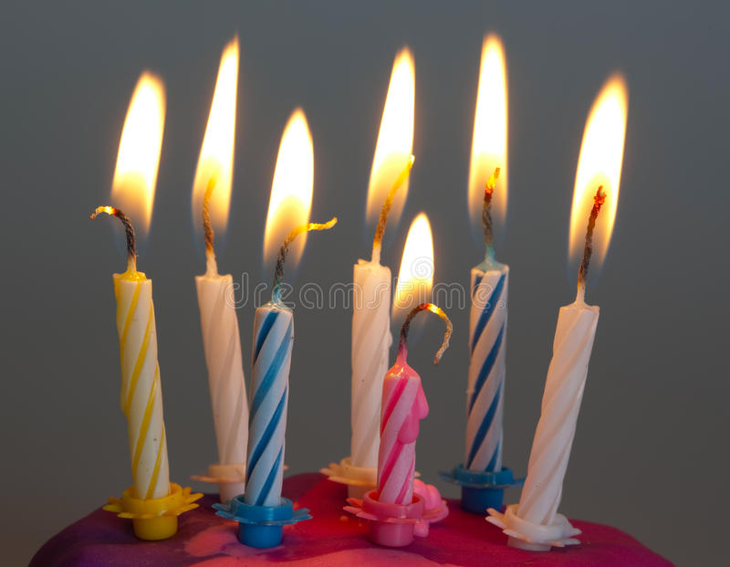 Birthday candles burning stock image
