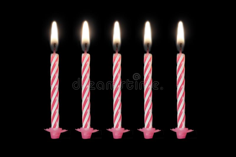 Birthday candles isolated on black background. Set of 5 pink birthday candles isolated on black background royalty free stock images