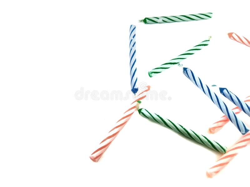 Birthday candles three colors on white background. Party, fun, sweet, flame, celebration, decorations, nobody, event, isolated, age, glowing, food, cake stock image