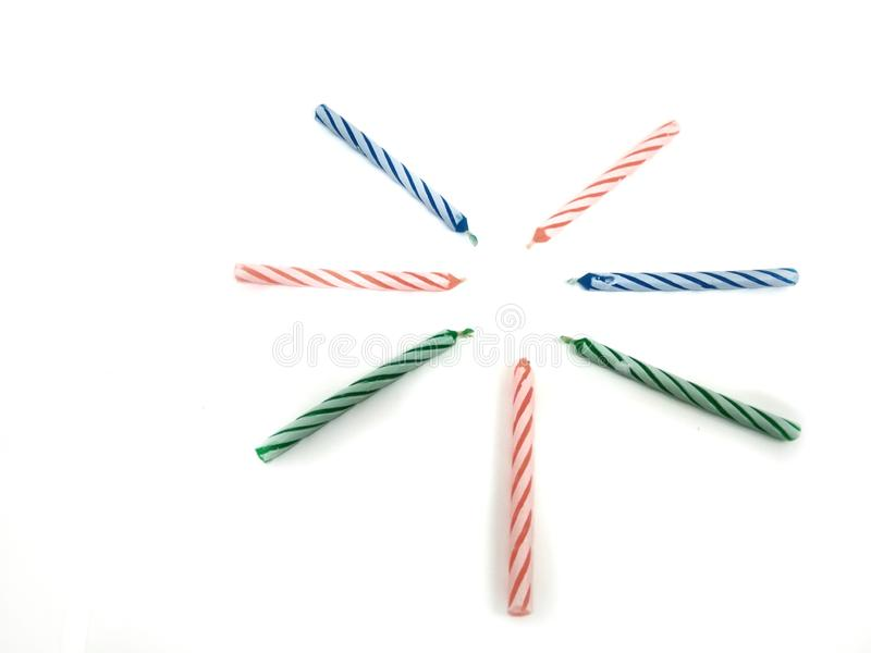 Birthday candles three colors on white background. Party, fun, sweet, flame, celebration, decorations, nobody, event, isolated, age, glowing, food, cake stock images