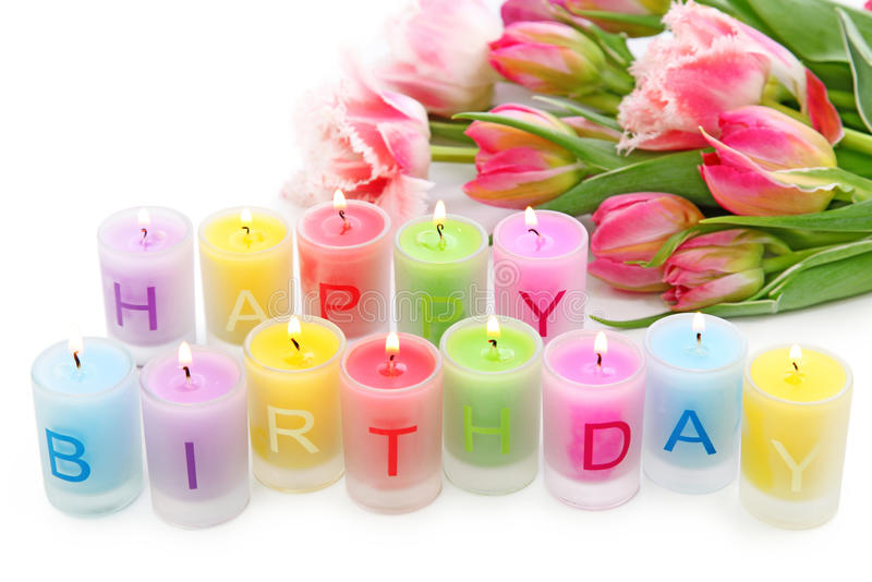 Birthday candles and tulips royalty free stock photography