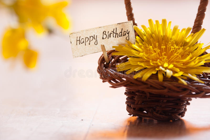 Birthday Card. Happy Birthday Card, yellow flowers and a basket royalty free stock photos