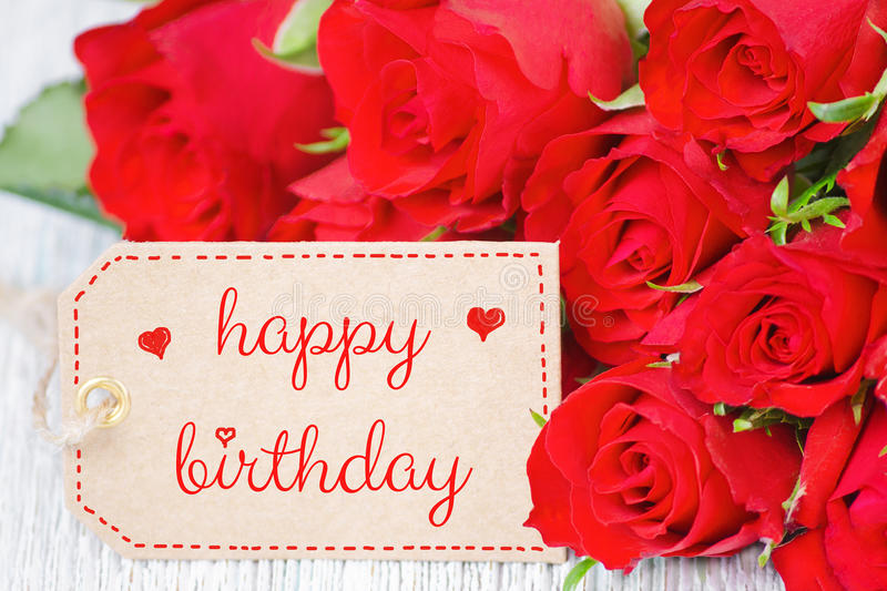 Birthday card red roses and a label with text happy birthday. Birthday card, red roses and a label with text happy birthday, closeup stock photos
