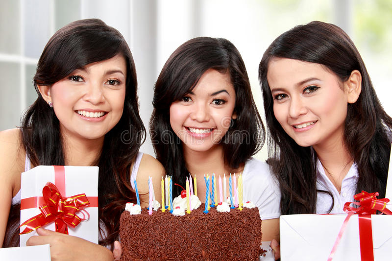 Birthday celebration. Young beautiful women celebrate birthday together with friends royalty free stock photos