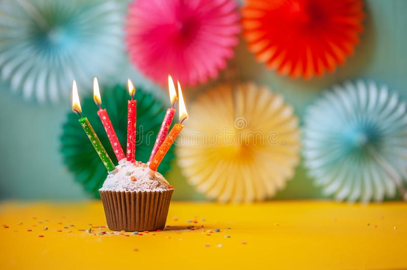 Birthday celebration with cupcake and colorful candles stock photos