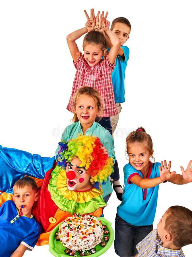 Birthday child clown playing with children. Kids give someone bunny ears. royalty free stock photos