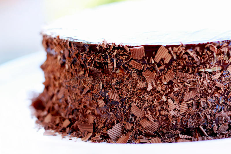 Birthday chocolate cake. Decorated with chocolate flakes stock photo