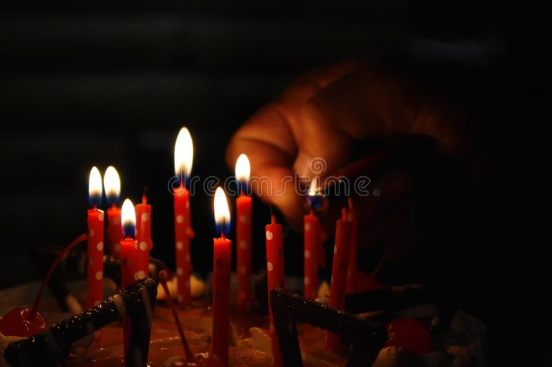 Birthday chocolate cake with candles stock photo