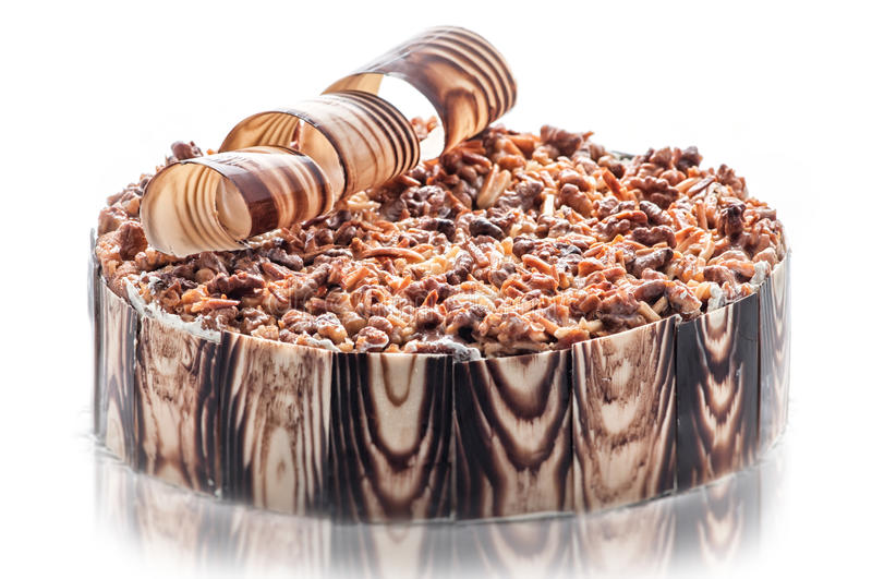Birthday chocolate cake with nuts and chocolate decoration, piece of cream cake, patisserie, photography for shop, sweet dessert.  stock image