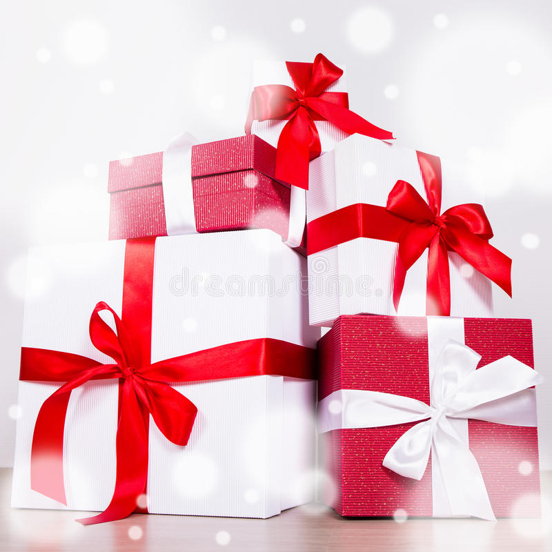 Birthday or Christmas concept - red and white gift boxes royalty free stock images