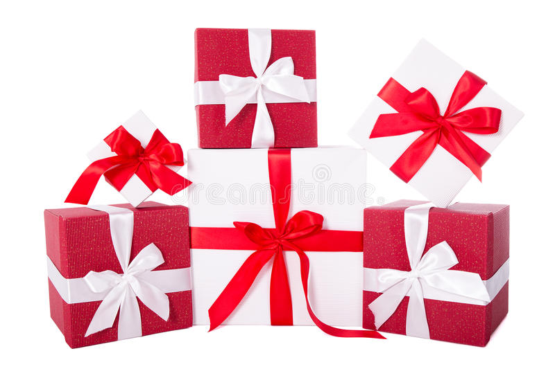 Birthday or Christmas concept - red and white gift boxes isolate stock images