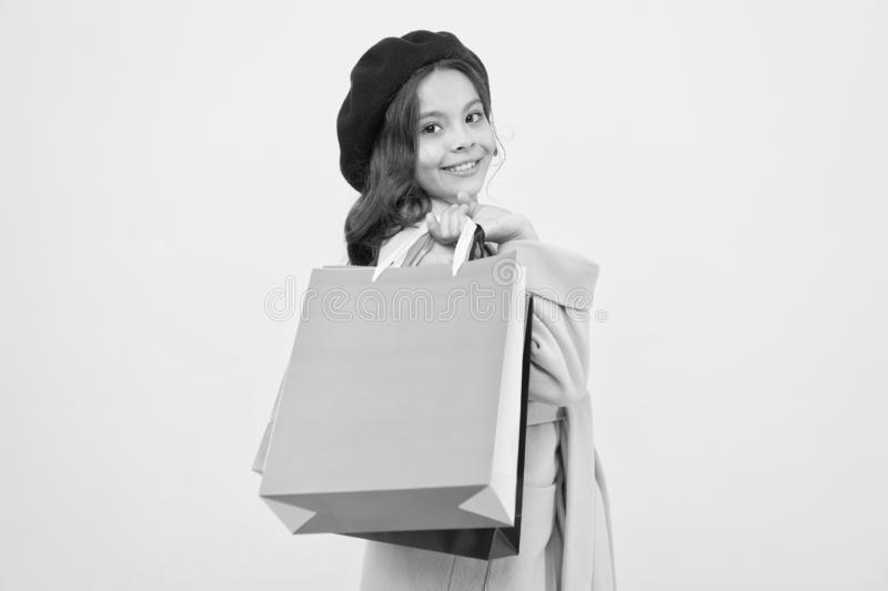 Birthday and christmas presents. big sale in shopping mall. International childrens day. small girl child with shopping. Bags. Happy shopping online. Quality stock photo