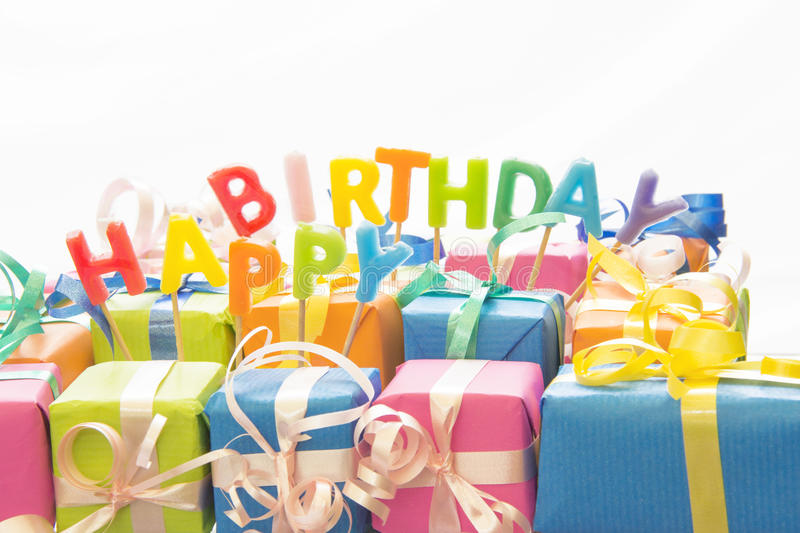 Birthday. Colorful Birthday Gifts With Candles on White Background stock image