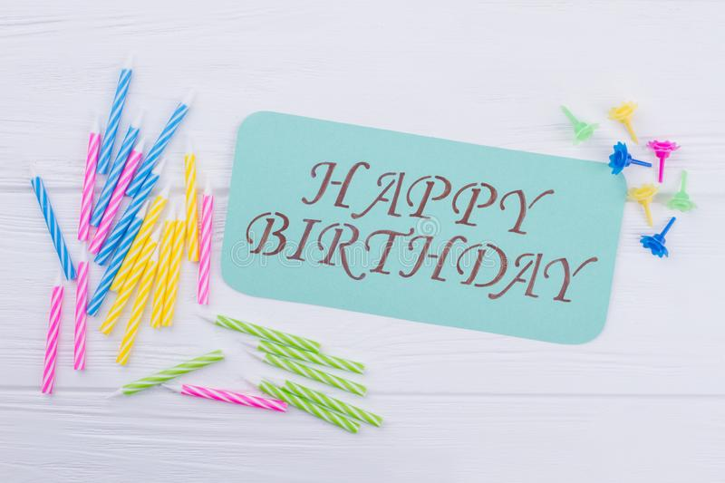 Birthday composition on white wooden background. stock images