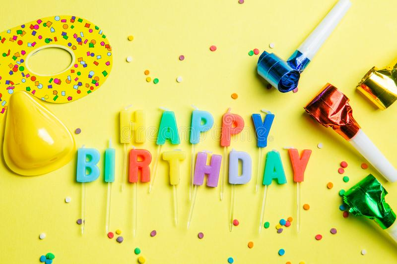 Birthday concept - candles with letters `happy birthday` and confetti stock images