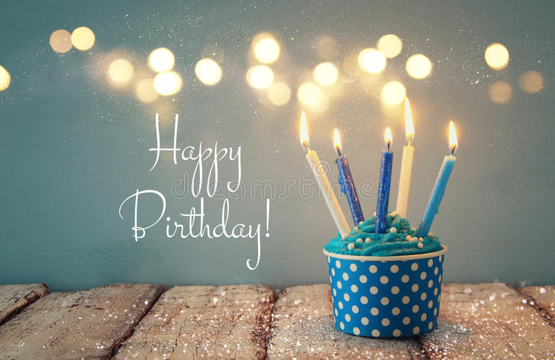 Birthday concept with cupcake and candles. Birthday concept with cupcake and candles stock images