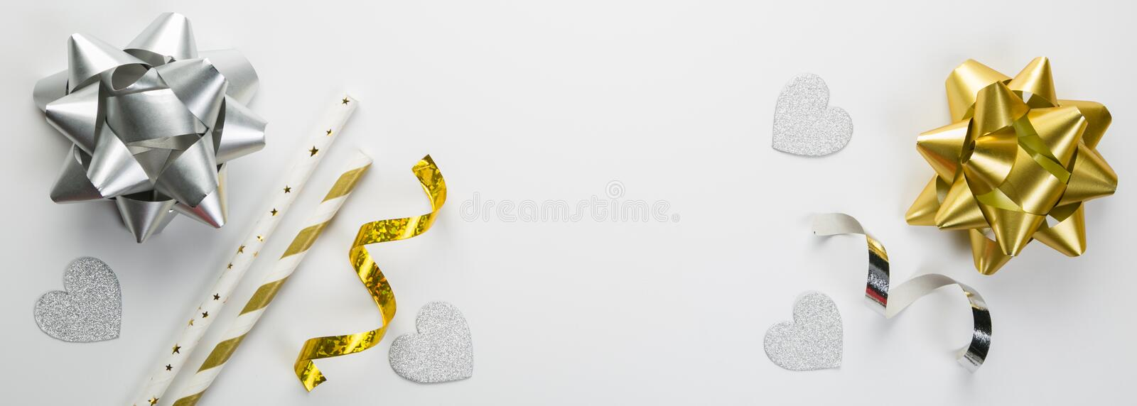 Birthday concept - silver and gold decorations on white background. Flat lay, top view royalty free stock photo