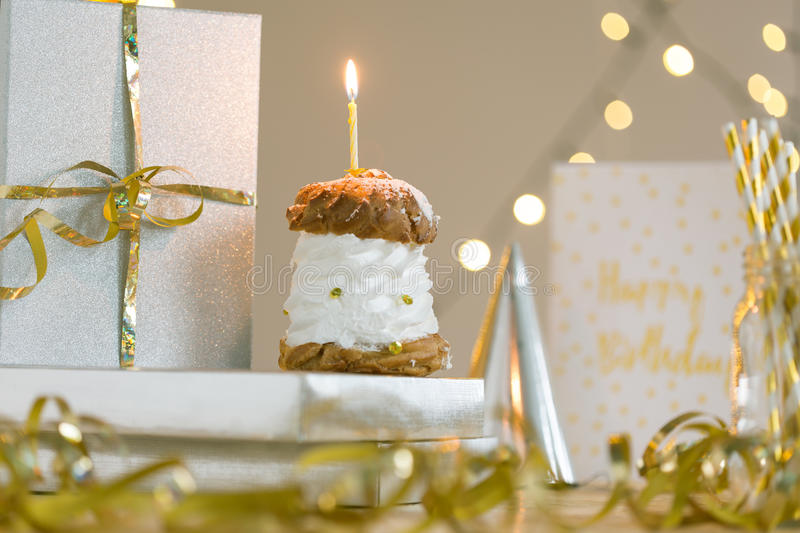 This birthday cream puff is so sweet stock photography