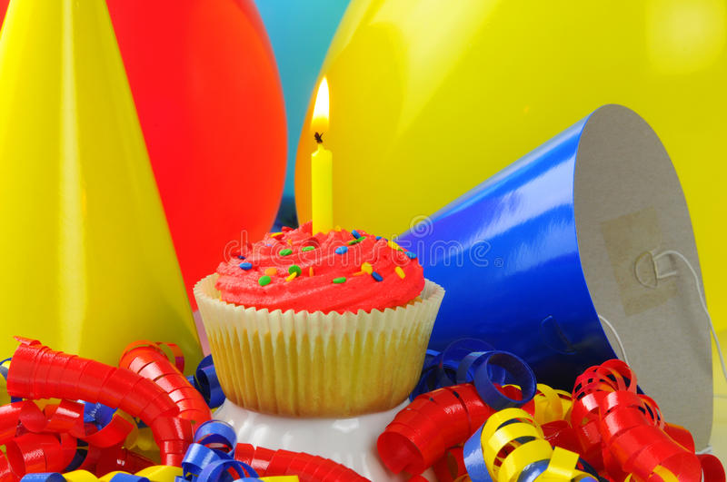 Birthday Cupcake. Colorful birthday cupcake with one candle royalty free stock image