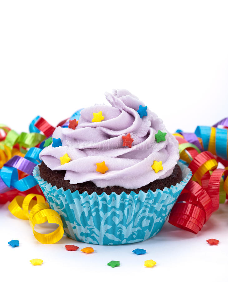 Birthday Cupcake. With colourful ribbon on a white background. Copy space stock images