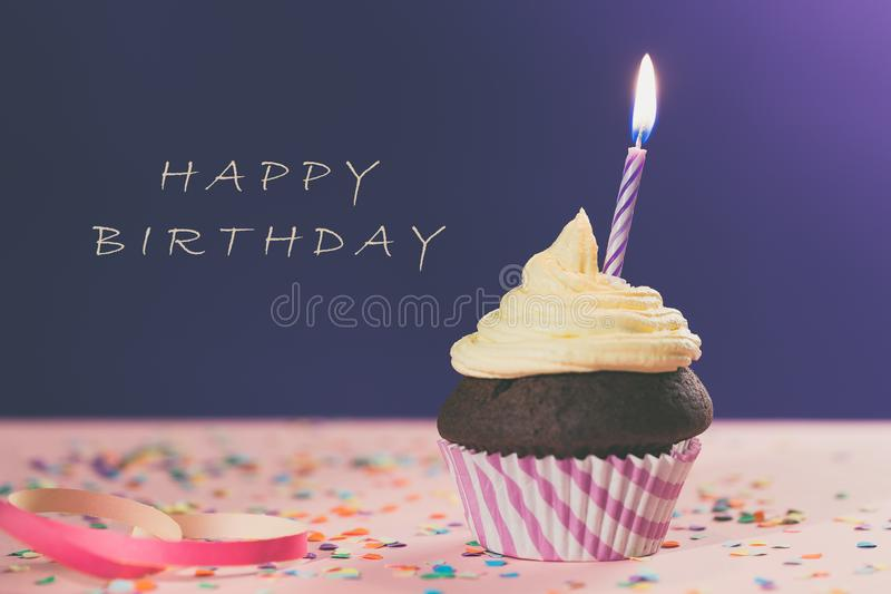 Birthday cupcake with candle stock images