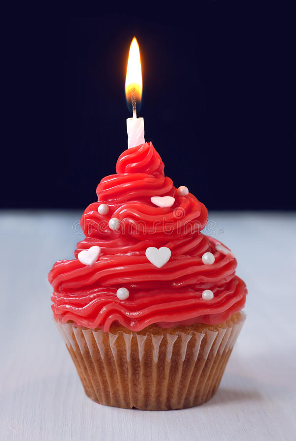 Birthday cupcake with candle. On wooden table royalty free stock image