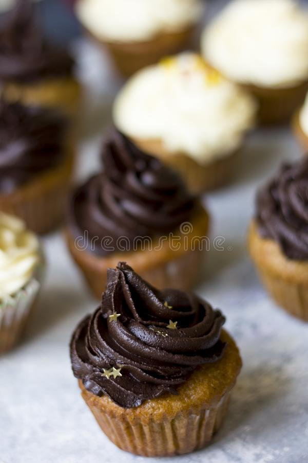 Birthday cupcake with the chocolate frosting on the top. Birthday cupcake with chocolate frosting on the top on the table royalty free stock photography