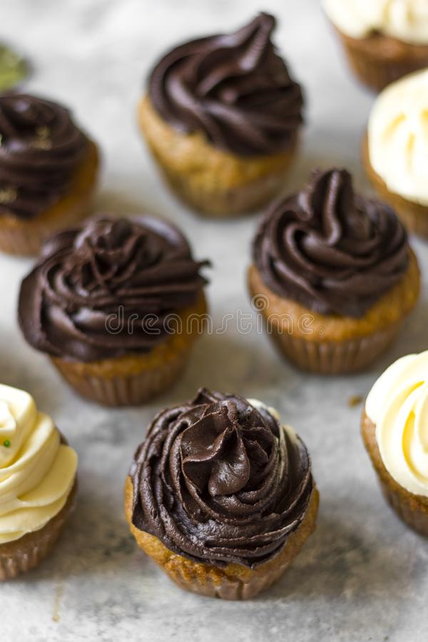 Birthday cupcake with the chocolate frosting on the top. Birthday cupcake with chocolate frosting on the top on the table royalty free stock images